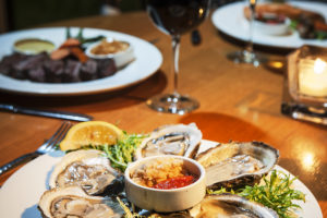 Oysters on the half shell are the perfect way to start your seafood dining experience by the Ocean