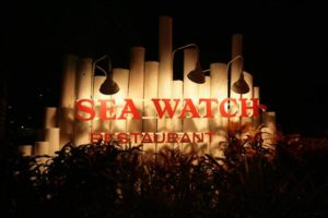 Sea Watch sign at night